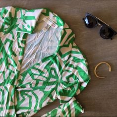 "Vintage Print DVF Top Green and white wrap top. Fits like a medium. Open to offers. 24"" long Diane von Furstenberg Tops"