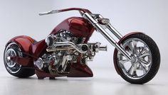 "A magnificent all-metal monster from Carl Brouhard Designs, this 4-cylinder, dual turbocharged Harley-Davidson culls about 230 hp from its twin-engine configuration—enough to rule any road. Its power pairs with a profile made prominent by the dropped chassis and anchored by the 360 mm rear tire on a 14-inch rim.    	    	""I wanted to build something over-the-top,"" says Brouhard. ""My goal was to win the award for 'America's Most Beautiful Motorcycle' at the Los Angeles Roadsters Show, and…"