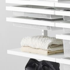 Recommended spacing between each shelf is 35 cm, when you store folded clothes. This way you won't get an overloaded closet.