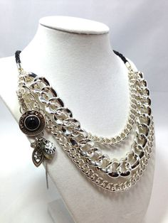 This listing is for a Silver Multi Chain necklace. It is a Chunky Statment necklace that is elegant and has three strands of silver chains and