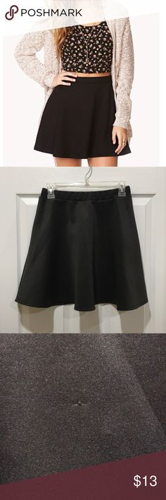 """Lust N Must Black Skater Skirt 🖤 This Lust N Must black skater skirt has been loved! It is a perfect skirt to throw on with a tee and chucks or as styled in the cover photo with a crop top, cardigan, and heels!  -Length: 16.5"""" -Waist: 26""""  There's one small (barely noticeable snag) in the front of the skirt pictured above and reflected in the price. There is no size tag but it is Medium, please see measurements if you're unsure. Care instructions have faded. Lust N Must Skirts Circle…"""