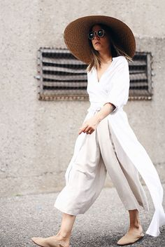 The Best Outfit Ideas Of The Week: Fashion blogger 'The Fashion Medley' wearing a straw floppy hat, round sunglasses, a white slit shirt tunic, beige culottes and nude mule flats. Summer outfit, casual outfit, comfy outfit, summer vacation outfit, summer getaway outfit, beach outfit, summer travel outfit, fresh outfit, neutral tone outfit, neutral color outfit, summer trends 2016