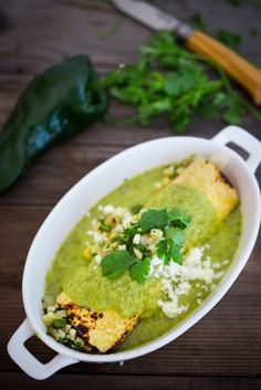 Enchiladas Verde with Corn, Chicken ( or Black beans) and Roasted Poblano Sauce. A simple healthy Mexican inspired meal that is easy and flavorful! Mexican Food Recipes, Whole Food Recipes, Cooking Recipes, Ethnic Recipes, Mexican Meals, Mexican Dishes, Poblano Sauce, Tomatillo Sauce, Quesadillas