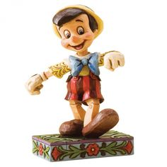 Jim Shore Disney Traditions Pinocchio Lively Step Figurine