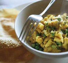 Cauliflower, pea and potato curry with poppadums