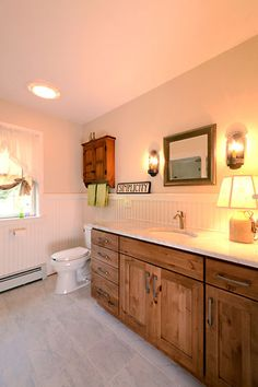 Bathroom remodel in Suffield, Connecticut. Remodeled by Don Roy with Custom Marble Kitchens and Baths in Agawam, Massachusetts. Fieldstone Cabinetry Farmington door style in Rustic Alder finished in Rattan with Chocolate glaze.