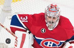 Montreal Canadiens goaltender Carey Price makes a save against the Ottawa Senators during the first period of Game 5 of a first-round NHL hockey playoff series, Friday, April 24, 2015, in Montreal. (Graham Hughes/The Canadian Press via AP)