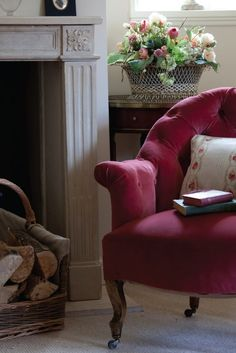 comfy chair, book, and fireplace