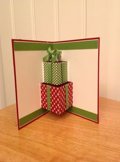 Stampin Up pop up Christmas card inside with present. $6.00, via Etsy.