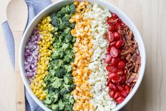 Amazing salad recipe with Cauliflower, broccoli, tomatoes, bacon and corn. With a homemade garlic and mayo dressing.