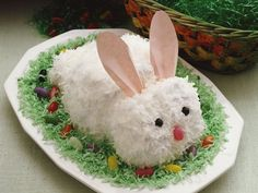 Easter Bunny Cake - Remember old-fashioned cutout cakes? This cute bunny is easily made from carrot cake mix frosted and covered with mouthwatering coconut.