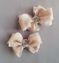 So head over heels about these blush antique lace bows trimmed in rhinestones with a blush silk chiffon underlay. What is better than one bow? Two bows! Heck, these arent even just shoe clips. You can clip these anywhere your heart desires. I wont tell.  Only one pair of these shoe clips available!  Bow itself measures about 3 1/2 inches wide (about 9 cm).  Extremely limited supply on these. Please check out my other listings for coordinating pieces while available.  These are ready to ship
