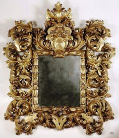 An outstanding Roman mirror with a large Baroque frame in pierced gilt wood, symmetrically carved as scrolled leaves around leaves in ear. A heraldry shield adorned with an angel head. Mirrored Picture Frames, Antique Picture Frames, Antique Frames, Antique Mirrors For Sale, Vintage Mirrors, Decoration Baroque, Baroque Mirror, 3d Cnc, Wood Mirror