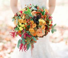 Roses, spray roses, baby button poms, china berry, scabiosa pods, amaranthus and various fall foliage.