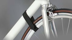 Parax d-rack.  Check out bicimag.com Leather strap comes with the bike rack to attach the wheel to the down tube. Avoids dirty stripes on the wall. #bike #rack #bikerack #paraxgermany #Fahrrad #Halterung #schindelhauer #Leder #kebony #fixie #cycling #roadbike #wall #kickstarter # startup #cycling #design #industrial #space saver #hangers