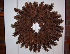 to make a beautiful pine cone wreath -- without gluing or wiring --> pretty nifty idea, but may not work with really old cones. Pine Cone Art, Pine Cone Crafts, Frame Wreath, Diy Wreath, Wreath Making, Wreath Ideas, Pine Cone Decorations, Christmas Decorations, Fall Crafts