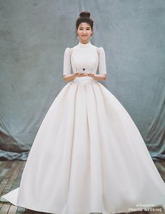 This classic white wedding gown from Clara Wedding featuring an unique illusion shoulder design is effortlessly beautiful! » Praise Wedding Community