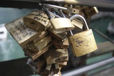 Locks on a bridge where couples write their names and through the keys into the river over Venice Italy.
