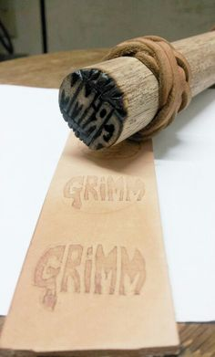 A hand-made leather stamp. This would actually be a great woodcarving project of a negative image cut into the end grain.