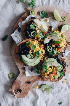 Summer tostadas with spicy black beans, avocado and corn salsa #vegan | http://TheAwesomeGreen.com