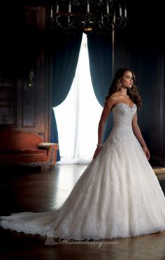 Embellished Strapless Sweetheart Gown by David Tutera   Item #213250 by David Tutera (Fall, 2013)        $1,573.00  Be radiantly beautiful in David Tutera 213250. This ball skirt wedding gown is made of soft lace and tulle. The strapless bodice features a sweetheart neckline and a low cut back. Jewels encrust the neckline while beaded embroidered lace appliques adorn the bodice. The scalloped hemline and chapel train compliment the style. Note: Detachable spaghetti and halter straps…