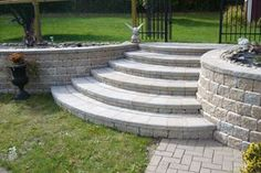 Terraced paver patio and stone patio terrace. See how terraces can be used to create useable space for pools and patios. Retaining Wall Steps, Landscaping Retaining Walls, Front Yard Landscaping, Landscaping Ideas, Brick Steps, Patio Steps, Stone Steps, Sloped Backyard, Backyard Patio Designs
