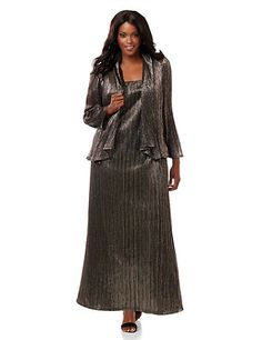 Light up the night with this sparkling jacket dress in a cascading metallic fabric. The long gown comes with a matching removable sheer jacket over top. This two-piece style is designed to get you noticed for all of your special occasions. Dress: Square neckline. Thick straps. Back zip opening. Fully lined. Jacket: Long sleeves. <br /> <br /> You can ship this style back to us for <strong>FREE!</strong><br /> A free return shipping label will be provided with your order.<br /> <strong>Al...