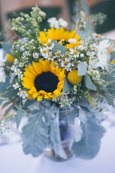 Bridal bouquets Sunflower wedding. Sunflower and wheat. Dusty miller, fever few, wax flower, Scabiosa, solidago, chamomile, Queen Anne's lace, eucalyptus. Beer themed wedding. Wild flowers. Botanic garden wedding. Photo credit: Emilyelizabethphoto.com Joliefloral.com