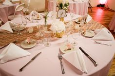 """Wedding Colors: Soft pink/peach and gold! Soft pink tablecloths with gold lace runners. Centerpeices included 24"""" eiffel tower vases with ostrich feathers, antique and gold painted vases with flowers, pearls and feathers :)"""