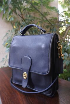 the vintage navy Coach Station bag