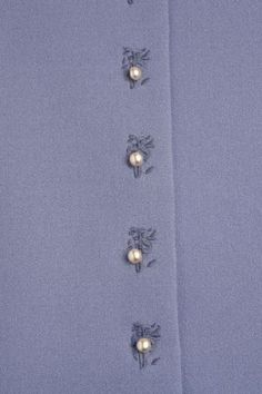 Machine Embroidery Embellish your buttonholes with this embroidery technique from Jennifer Stern. - Embellish your buttonholes with this embroidery technique from Jennifer Stern. Embroidery Thread, Machine Embroidery Designs, Embroidery Patterns, Sewing Patterns, Sewing Hacks, Sewing Tutorials, Sewing Crafts, Sewing Projects, Embroidery Techniques