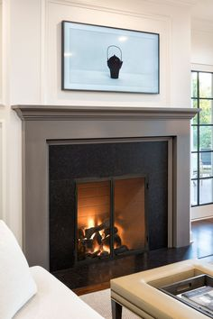Juxtaposing modern art and a traditional fireplace is a pairing we can get behind. Loving the minimalist feel of this artisan home, featuring our Rutherford wood fireplace. Linear Fireplace, Wooden Fireplace, Home Fireplace, Fireplace Inserts, Fireplace Gallery, Building A New Home, Building Ideas, Indoor Outdoor Fireplaces, Brick Paneling