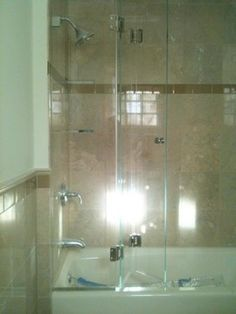 Bi Fold Frameless Door For Tub   Traditional   Showers   New York   ATM  Mirror