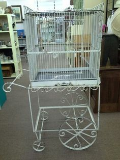 $175 -This vintage large square birdcage siting on its iron stand with wheels for easy relocating makes a great decorator piece. **** In Booth G2 at Main Street Antique Mall 7260 E Main St (east of Power RD on MAIN STREET) Mesa Az 85207 **** Open 7 days a week 10:00AM-5:30PM **** Call for more information 480 924 1122 **** We Accept cash, debit, VISA, Mastercard, Discover or American