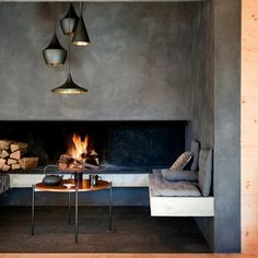 Loving everthing here, the exposed concrete, the lighting, the fireplace and the seat! Cabbagerose Tumblr Inspiration