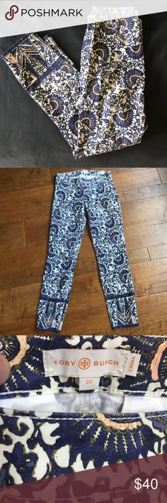 "Tory Burch Floral jeans Never worn. New. No tags. Beautiful blue, white and coral jeans. Style is called Cropped Skinny jeans. Has a side zipper. Inseam 27.5"", rise 8"" They are stretchy and comfortable. Tory Burch Jeans Skinny"