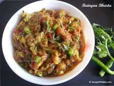 Baingan Bharta or Baingan Ka Bharta is a North Indian style dish prepared with roasted eggplant that is grilled over charcoal or direct flame, mashed and a
