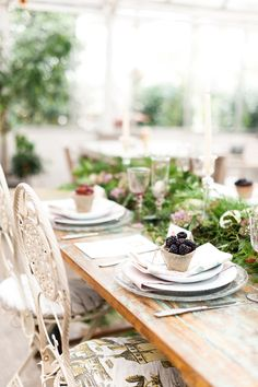 Utterly delicious tablescape with green harvest centerpiece and little tubs of natures bounty berries on each place setting. Summertime loving outdoors picnic setting