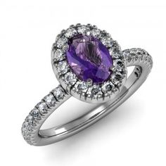 Oval Amethyst & Diamond Halo Ring set in 18K White Gold. (7x5mm)