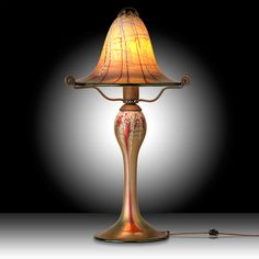 This petite sized Luster Art Glass table lamp with a Cherry Blossom design is hand blown to order by renowned glass artisan Carl Radke.    #myOCLlight #oldcalifornia #oldcalifornialighting #craftsmanlighting #madeinamerica #solidbrass #artsandcrafts #lusterglass #tablelamp