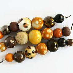 African beads, 21 handmade ceramic beads, brown, black, leopard print, Handmade Beads, clay beads, bead shop, art beads, made in Africa from EarthButterBeads on Etsy Studio