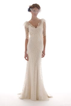 I'm currently obsessed with Elizabeth Fillmore Bridal.     Like COMPLETELY obsessed. I'm in love with so many of her gowns.