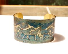 A great etched brass cuff for horse lovers - Blue HORSE Bracelet 1.5 inches wide, by Joann Hayssen Designs SRA $35.00 - 20% of the purchase price will be donated to Rosemary Farm horse rescue and sanctuar https://www.etsy.com/listing/193464259/blue-horse-bracelet-etched-brass-cuff-15?ref=shop_home_active_1
