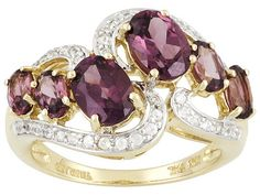Umba River Rhodolite 1.78ctw Oval With White Zircon .24ctw Round 10k Yellow Gold Ring