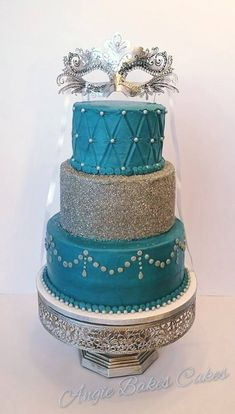 Silver and teal blue Masquerade Ball or Mardi Gras cake with mask topper