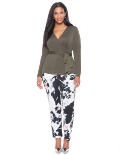 Pattern pants made work appropriate with a neutral wrap top. Finish the look with a metallic pump.