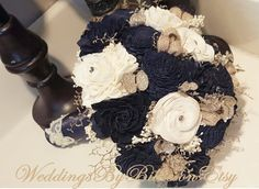 Navy Blue Sola Bouquet, Blue Champagne Ivory Bouquet, Wedding Flowers, Rustic Shabby Chic,Bridal Accessories, Keepsake Bouquet, Sola Flowers  ****** Details *******   Beautiful all natural Sola Bouquet. Shown in navy blue, champagne and ivory. Made with natural ivory sola flowers, navy solas, burlap roses and petite champagne pedals. Other colored sola flowers also available-In any color- as I hand dye them myself. This bouquet will last a lifetime! See link below for other colored/natural…