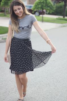 Love a dressy skirt witha graphic tee...