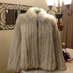 🎉2X HP's🎉10/24🎉12/5🎉SILVER FOX COAT Natural Blue Silver Fox Coat of Finland Made for JACQUES ARAN of New York & Paris. Has a inside pocket and 2 outside pockets. Lining is 100% BEMBERG soft as satin! My mom wore it a couple times! We live in Florida and really don't wear warm things like this! She has had it professionally cleaned and stored! Host Picks X2 10/23, 12/5/ FINAL PRICE! Jacques Aran Jackets & Coats