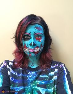 Becky: This is me wearing an original design of a pop art zombie. It took 2 1/2 hours to paint, plus lots of planning and trial runs.